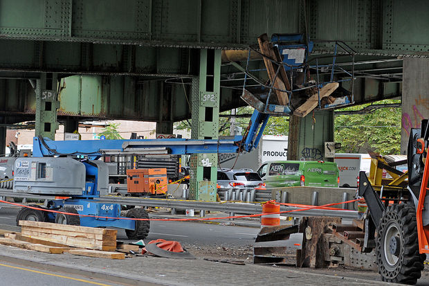 A worker was injured after a steel beam fell from the Gowanus Expressway near 61st Street and struck a lift he was in, Oct. 23, 2017.