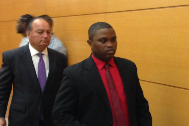 NYPD officer Wayne Isaacs (right) leaves the courtroom on the first day of his trial in the shooting of Delrawn Small.