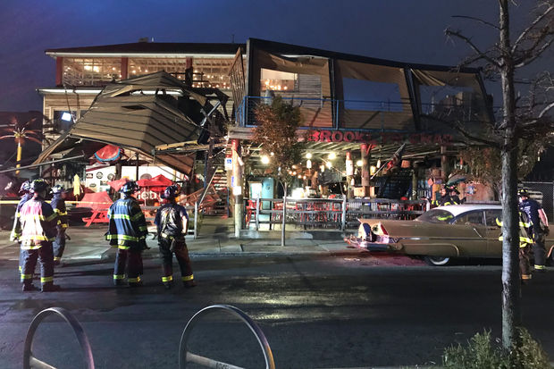 An awning collapsed at Brooklyn Crab in Red Hook on Tuesday morning, likely from the wind, according to the FDNY.