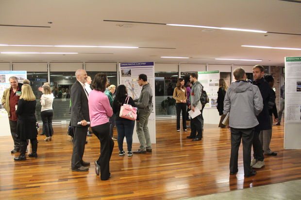 Neighbors gathered at Center on Halsted before the Red and Purple Modernization Phase One meeting on Monday. The CTA had detailed project information on boards in the lobby.