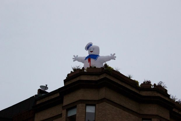 The Stay Puft Marshmallow man has returned to its rooftop perch at Grand and Wells, humoring passersby.