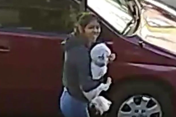 She grabbed the dog, 2, from a 37th Avenue yard and hadn't been arrested as of Wednesday, police said.