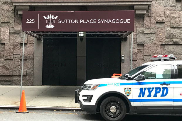 Police guarded the door of the Sutton Place Synagogue two days after vandals spray-painted a swastika on the door there.