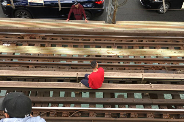 The FDNY was called to the Williamsburg Bridge for a man sitting on the subway tracks, officials said.