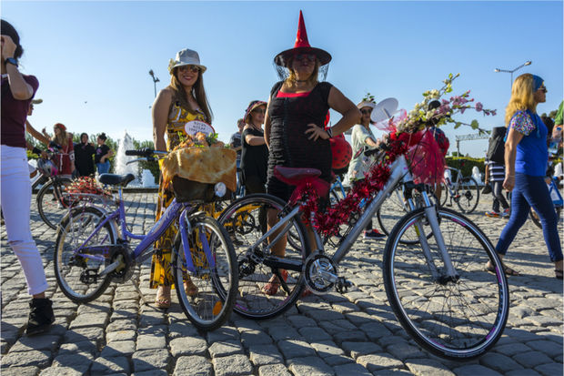 Bicyclists can be seen in costumes in this file photo.