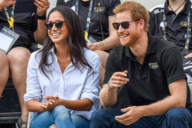 Prince Harry and rumored fiancee Meghan Markle made their first public appearance together at the Invictus Games in Toronto.