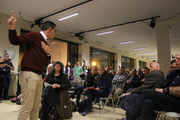 Anthony Joel Quezada, the alderman's staffer, addressing the crowd during an emotionally charged moment at the meeting, held Monday evening at Hairpin Arts Center.