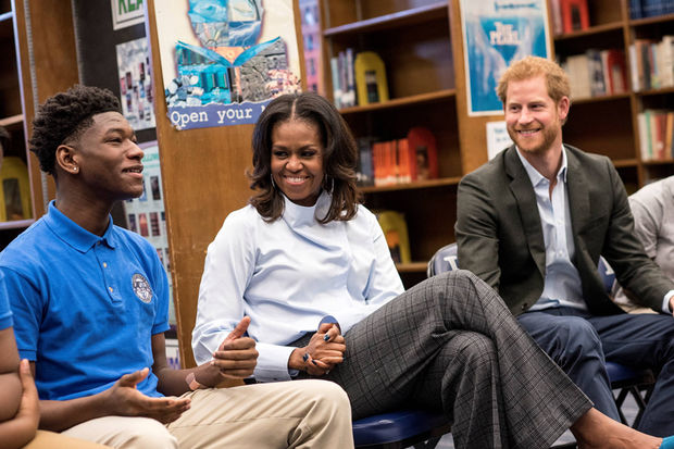In a Halloween surprise, former first lady Michelle Obama and Prince Harry popped in on students at Hyde Park Academy High School Tuesday afternoon.