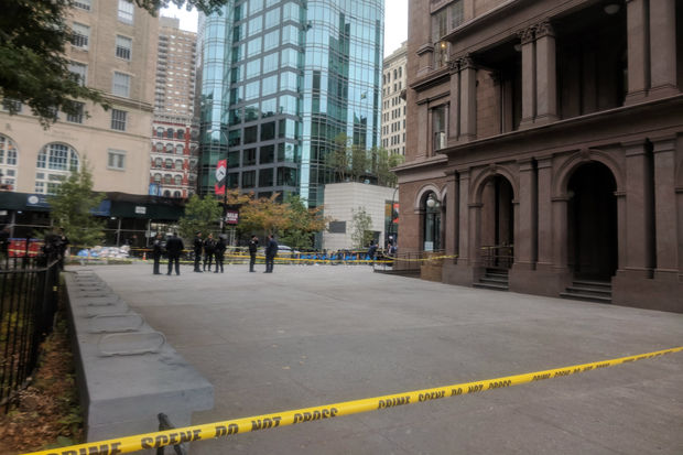 A man and woman suffered life-threatening injuries in a double shooting near the Cooper Union Wednesday morning that may have been a murder-suicide attempt, police said.
