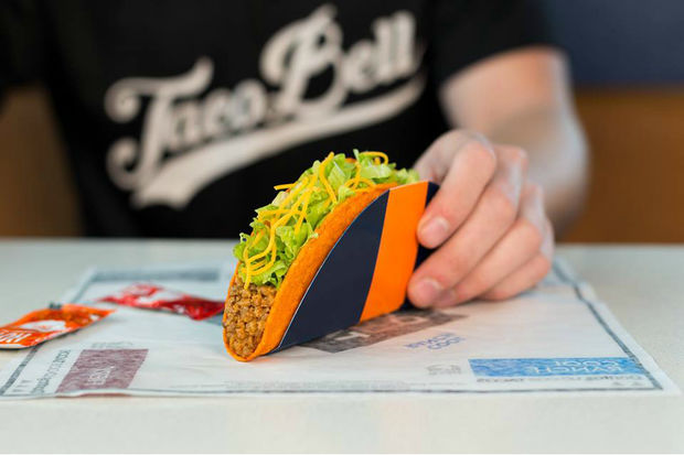 Taco Bell is giving away free Doritos Locos tacos Wednesday afternoon in a cross-promotion with the World Series.