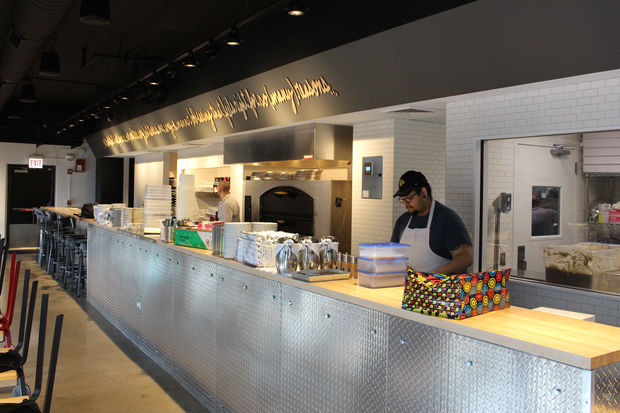 Staff at Pizzeria Bebu prepares for Thursday's opening.