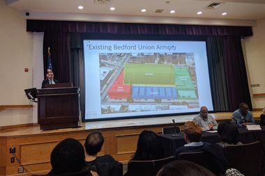 John Valladares of BFC Partners presents the development group's plan for repurposing the Bedford-Union Armory at a public meeting on the project held at Medgar Evers College Thursday night.