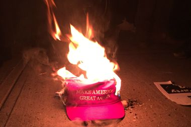 At a protest at NYU on Thursday, antifa activists ripped a Donald Trump hat from a man's head and set it on fire.