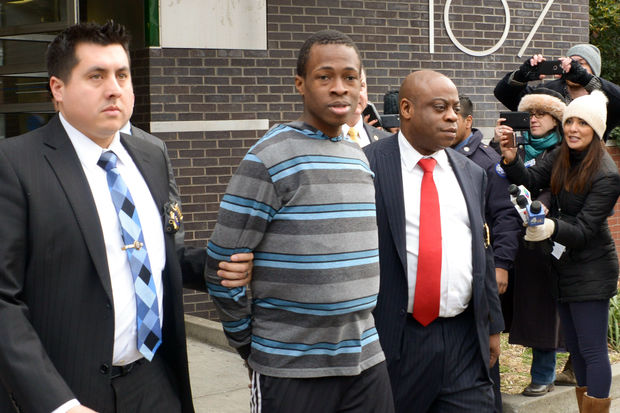 Chanel Lewis is escorted out of the 107th Precinct to be arraigned at Queens Criminal Court on Sunday, Feb. 5, 2017. He is accused of murdering Karina Vetrano in Gateway National Recreation Area on Aug. 2, 2016.