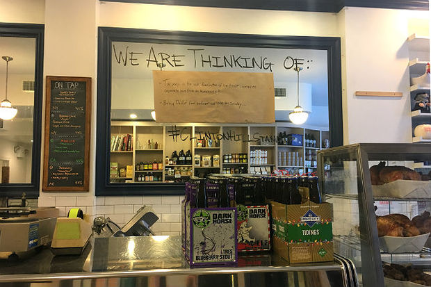 Peck's specialty food market is looking to spark conversation by posting daily thoughts on the Trump administration on a wall inside the store.