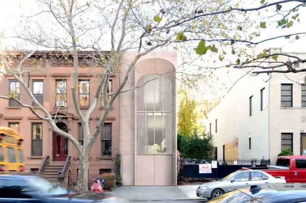 The Landmarks Preservation Commission approved the building design for the Clinton Hill Historic District.