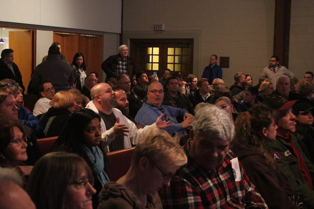 Neighbors packed into The Branch Community Church Thursday to jeer Ald. John Arena's (45th) proposal.