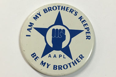A button for the African-American Police League insists,