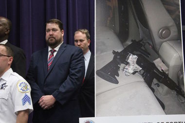 Police stand next to a photo of two assault rifles recovered by police Thursday night.
