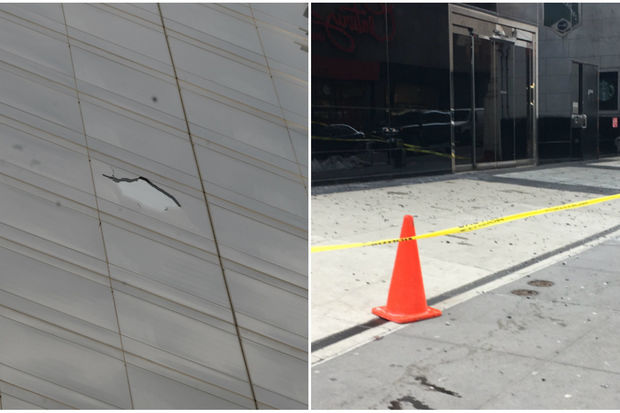 Small pieces of black glass were strewn about the base of 55 Church St. and a hole could be seen about 20 stories up.