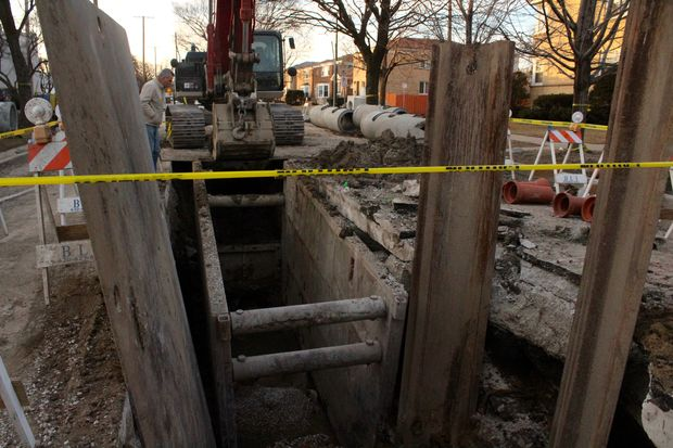 A trench collapsed on a water department worker who was helping replace an underground pipe near Peterson Avenue and Keeler Avenue, killing him, officials said.