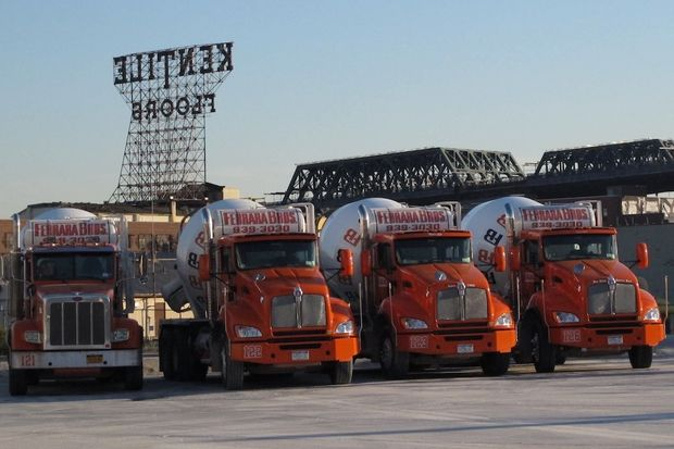 A 2011 shot of Ferrara Brothers cement mixers in Gowanus, with the now-gone Kentile Floors sign in the background. Ferrara is preparing to move to Sunset Park after more than 40 years in Gowanus.
