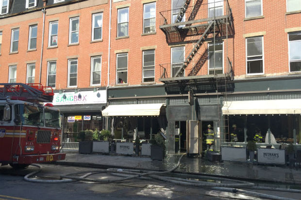 A fire broke out above Putnam's Pub & Cooker at 419 Myrtle Ave. just before 11 a.m. on Tuesday, according to fire officials.