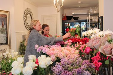 Libby Myer, left, makes custom bouquets at new flower shop Beetlebug.