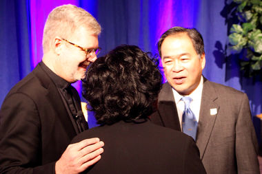 Outgoing DePaul President the Rev. Dennis Holtschneider talks with his successor A. Gabriel Esteban after Thursday's announcement. Holtschneider said,
