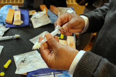 A Bed-Stuy resident learns how to administer naloxone at a training session in the Bedford Stuyvesant Restoration Plaza Wednesday afternoon.