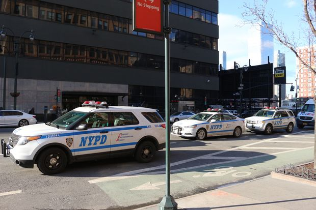 Midtown South Precinct officers frequently park their vehicles in a left turn lane on Ninth Avenue, a CB4 member said.