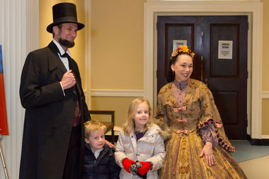 Actors portraying President Abraham Lincoln and his wife, Mary Todd Lincoln, stroll the Chicago History Museum on Monday.