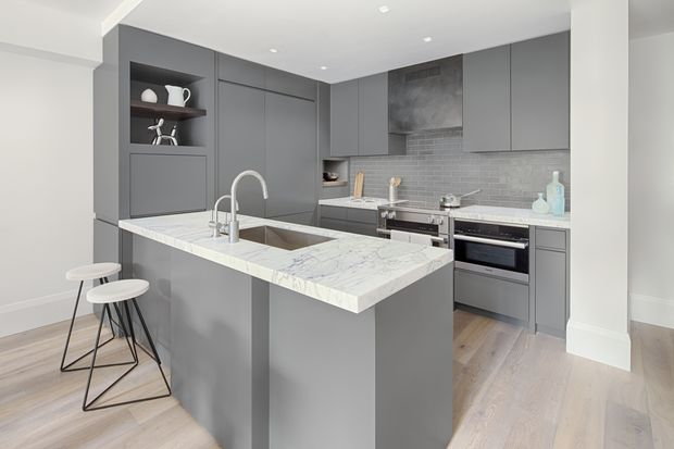The kitchen at 318 W. 47th St. has an induction stovetop, which is all the rage among designers right now. But since it's not something necessarily on would-be buyers' wish lists, the marketing team isn't promoting it in materials. They want the crowds to come first to see it for themselves.