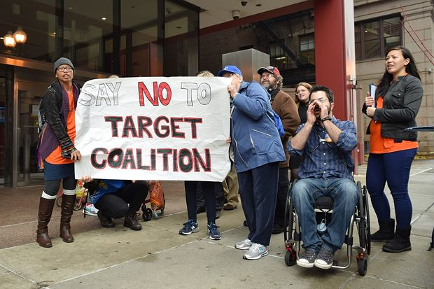 Seniors and other Rogers Park community members speak out against Target at a CHA board meeting Tuesday morning.