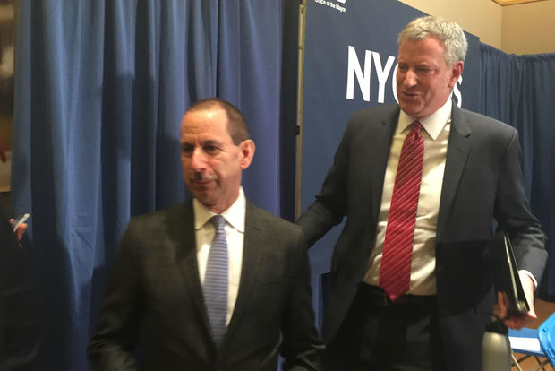New head of the Administration for Children's Services head David Hansell in front of Mayor Bill de Blasio on February 21, 2017 after he is announced as head of the agency.