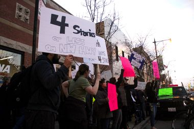 Protesters rally outside 45th Ward Ald. John Arena's office against proposals for a storage facility and apartment complex at 5150 N. Northwest Hwy.