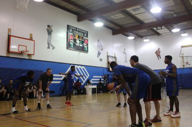 Players from the McCormick-Pederson Boys and Girls Club took on Lincoln District police in a basketball game Wednesday night.