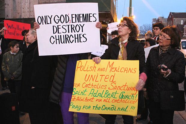 St. Adalbert Roman Catholic Church parishioners protest outside of the Pilsen church Wednesday night.