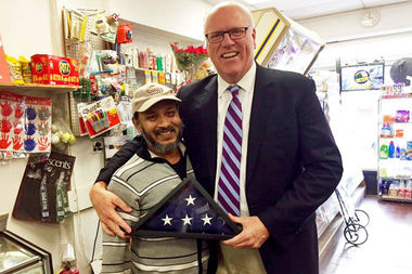 Sarker Haque with Congressman Joe Crowley in his store in the days after the attack.