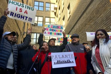 Elsia Vasquez, president of PA'LANTE Harlem, stands with tenants demanding HPD keep its promise to rehab their TIL buildings and allow them to buy their apartments for $250.