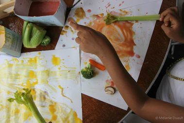 An organic arts studio where kids can paint with fruits and vegetables using non-toxic materials opened on Fulton Street in February.