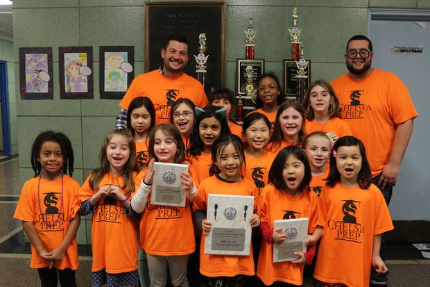 Coach Russell Makofsky, left, and coach Angel Lopez, right, with P.S. 33's girls' chess team.