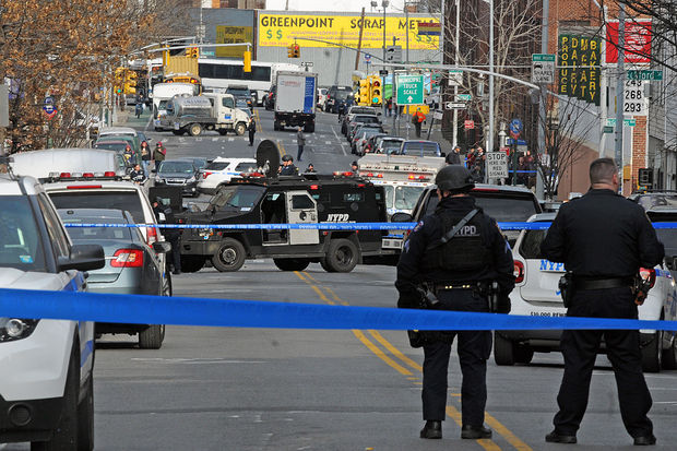 Armored vehicles and police in bullet-proof vests converged on 185 Greenpoint Ave. Monday afternoon.