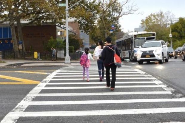 The DOT considers adding a pedestrian island in front of P.S. 220 in Forest Hills.