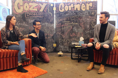 DePaul students Sydney Bickel, Joash Mencias and Andrew Willett talk in front of the Cozy Corner pop-up shop they use as part of the Tough to Be Tough campaign.