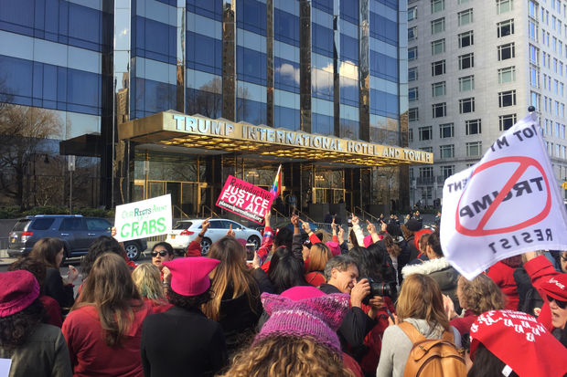 Women gathered outside Trump International Hotel and Tower to celebrate International Women's Day.