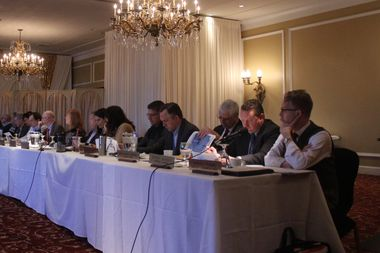 Chicago Department of Aviation deputy commissioner Aaron Frame (r) and aviation consultant Jeffrey Jackson (second from right) at Friday's meeting of the O'Hare Noise Compatibility Commission