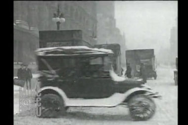 A video shows Chicago as it looked — old cars, historic buildings and all — during a minor snowstorm in 1920.