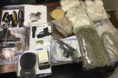 Police found guns, cocaine, heroin, and approximately 27 pounds of marijuana during their search of residences throughout Brooklyn and Manhattan, prosecutors said.