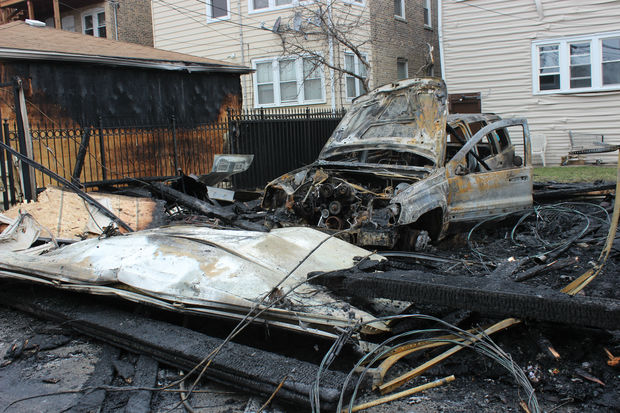 The scene of the garage fire as of Monday afternoon.